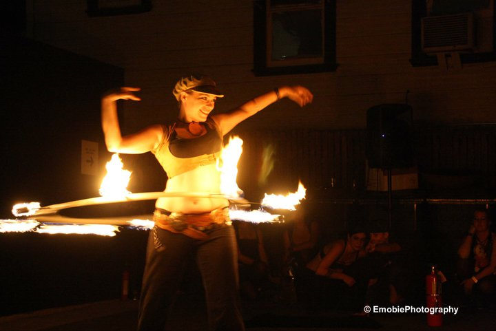 Maia Alexandra spinning fire with her Fire Hoop
